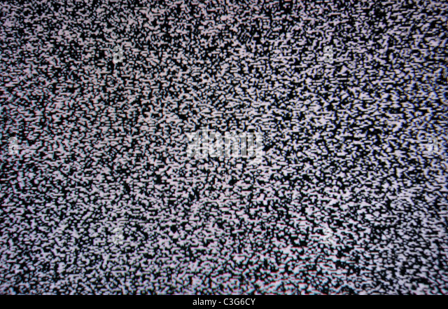 black and white TV screen noise texture pattern background - Stock Image