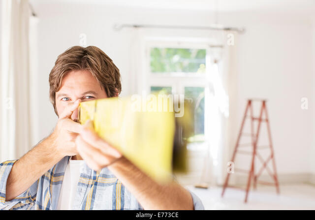 Man holding wood close to face - Stock Image