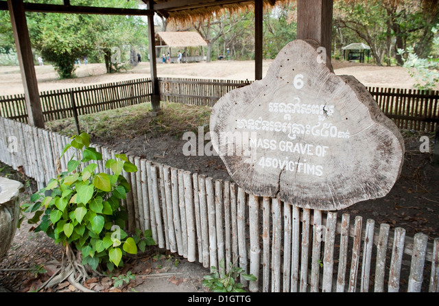 Sign reading Mass Grave of 450 Victims at The Killing Fields, Phnom Penh, Cambodia, Indochina, Southeast Asia, Asia - Stock Image