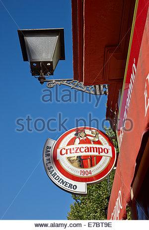 Sign for popular beer, Cruzcampo out side bar Sevilla, Spain Seville - Stock Image