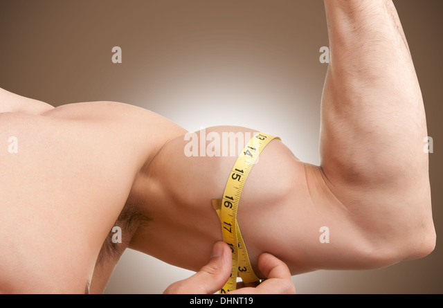 fit-man-measures-his-bicep-with-a-yellow