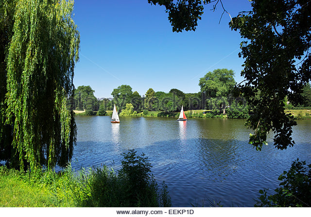 Some sail while others hike and cycle around on the Münstersche Aasee in Münster, Nordrhein-Westfalen, Germany. - Stock Image