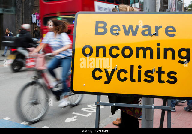 cyclist-with-a-sign-beware-oncoming-cycl