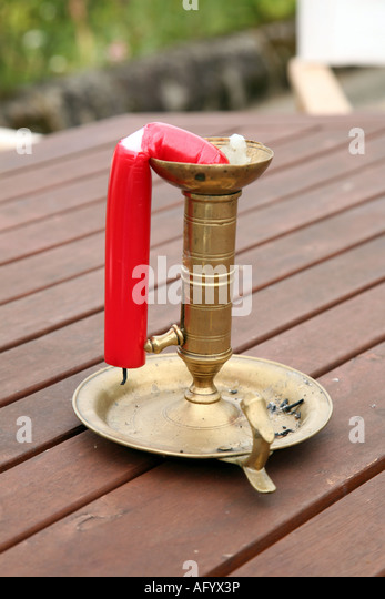 The droopy candle - The morning after the night before - Stock Image