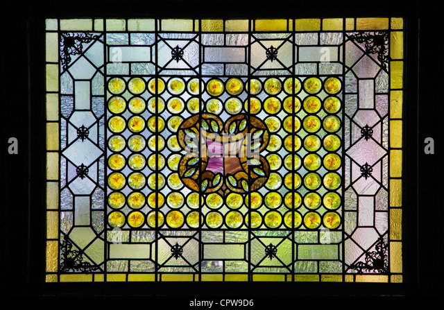 A classic Louis Comfort Tiffany stained glass window in St Augustine's Flagler college, Florida - Stock Image
