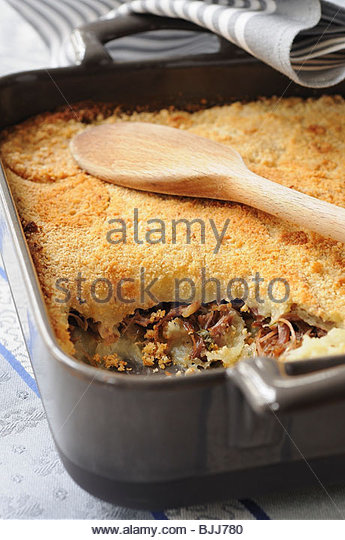 Baked duck and potato dish in a roasting tin - Stock Image