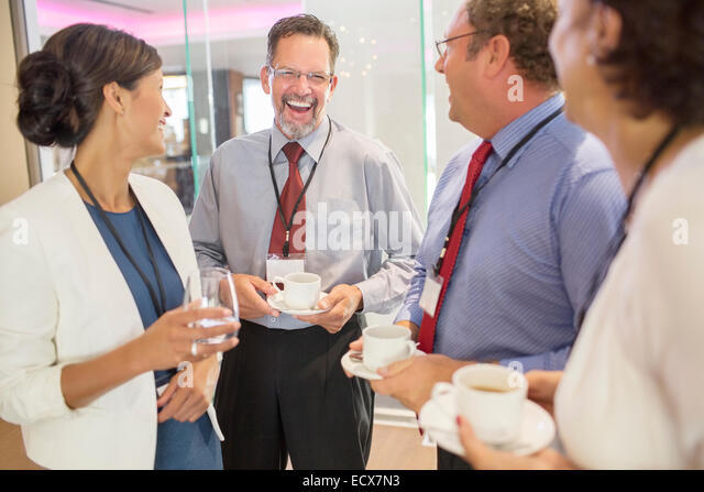 People in lobby of conference center during coffee break - Stock Image