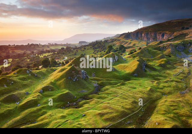 Sunrise over the sculptured landscape of Llangattock escarpment - Stock Image