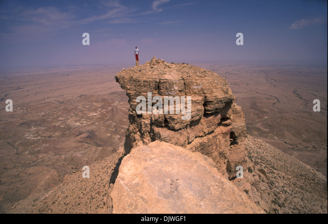 local-berber-youth-standing-up-a-rock-in