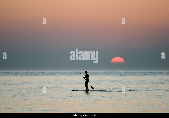 solitary-male-paddling-a-surfboard-in-ca