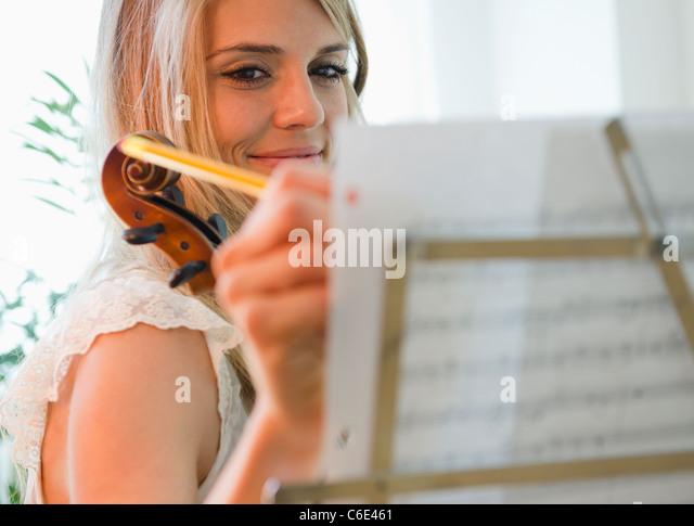 USA, New Jersey, Jersey City, Woman composing music - Stock Image