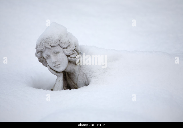 female-statue-largely-covered-with-snow-