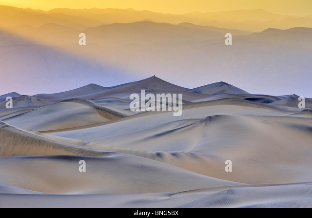 Sand dunes in a desert, Mesquite Flat Dunes, Death Valley, Panamint Range, California, USA - Stock Image