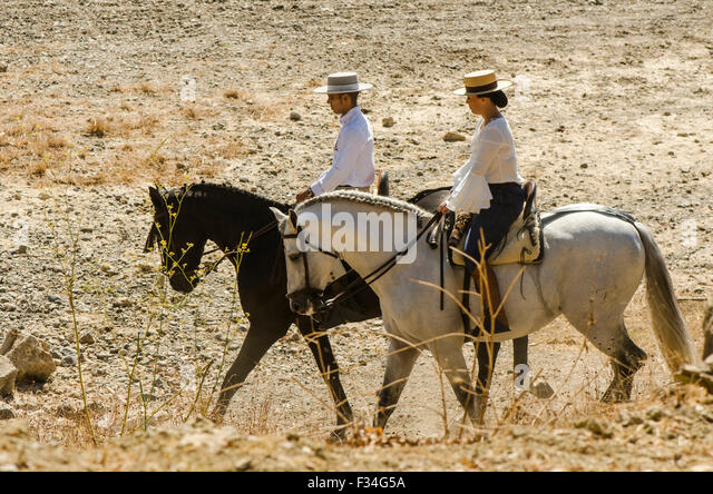 man-and-woman-on-horses-traditional-cath