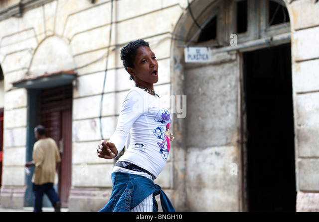 A girl dances in the streets of Havana Cuba - Stock Image