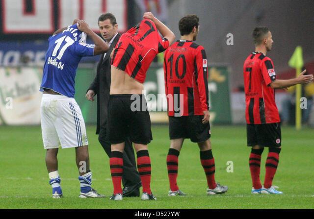 Jefferson Farfan of Schalke and Martin Fenin of Frankfurt exchange jerseys after a Bundesliga game of FC Schalke - Stock Image
