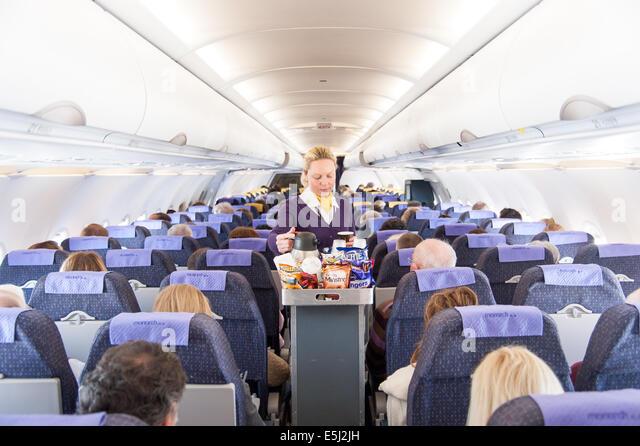 monarch-airlines-air-stewardess-serving-