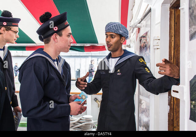 Aarhus, Denmark. 4th July, 2013. Crew member at The Royal Navy of Oman vessel Shabab Oman, introducing the ship - Stock Image