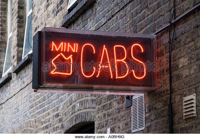 mini-cab-office-sign-london-england-uk-a