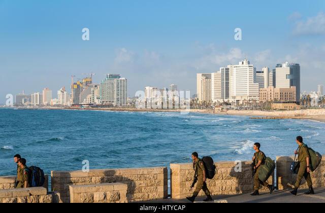 Soldiers walk on the promenade of Tel Aviv, Israel - Stock Image