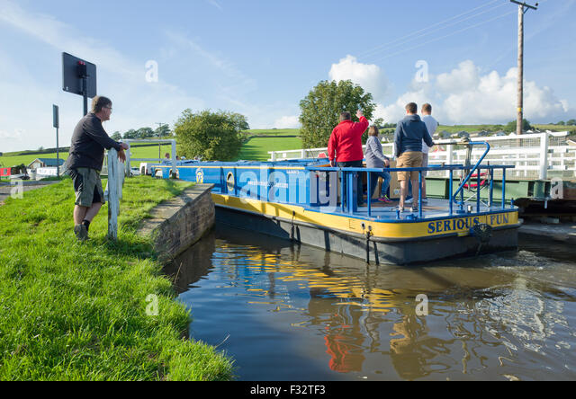 large-canal-boat-navigates-open-swing-br