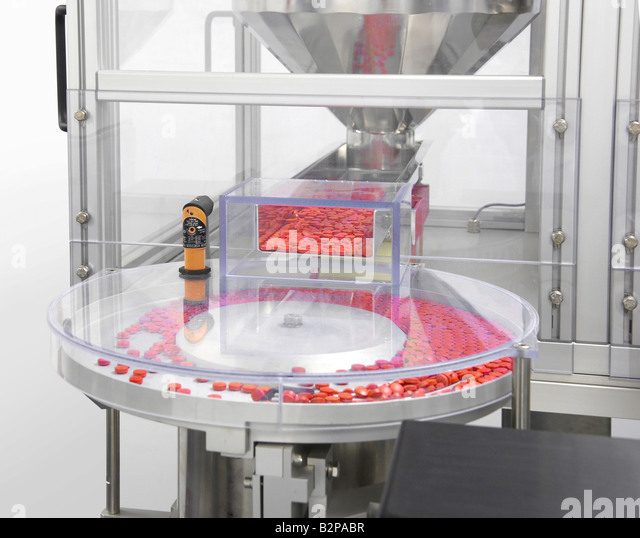 Machine Sorting Medicine Pills Before Filling - Stock Image