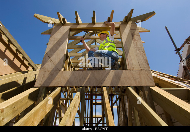 a-builder-working-on-the-roof-of-a-new-h