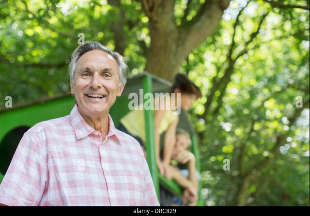 Man smiling outdoors - Stock Image