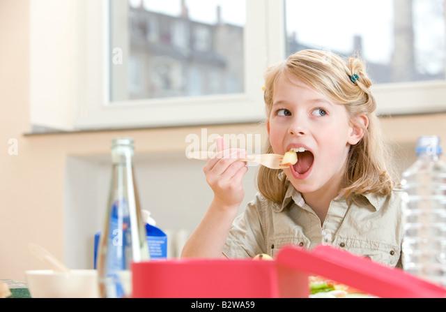Girl having lunch - Stock Image