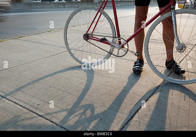 Cyclist with bike - Stock Image
