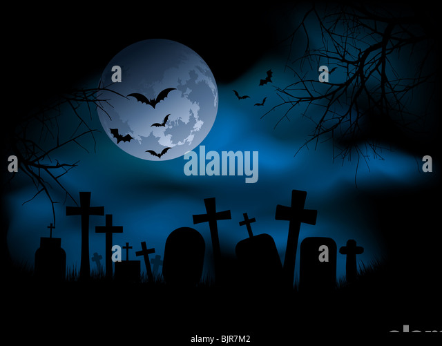 Spooky graveyard at night - Stock Image