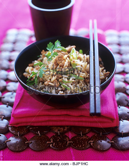 Fried rice with minced chicken and coriander leaves - Stock Image