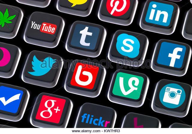 Social media icons on a computer keyboard. Social networking shortcuts. - Stock Image