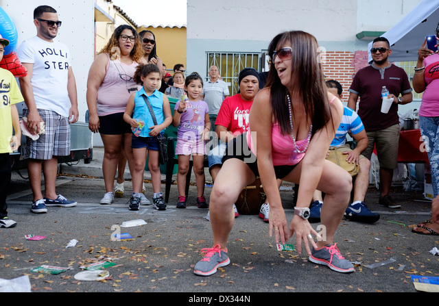 MIAMI - MARCH 9, 2014: Portrait of woman dancing in the streets during the 37th Calle Ocho festival, an annual event - Stock Image