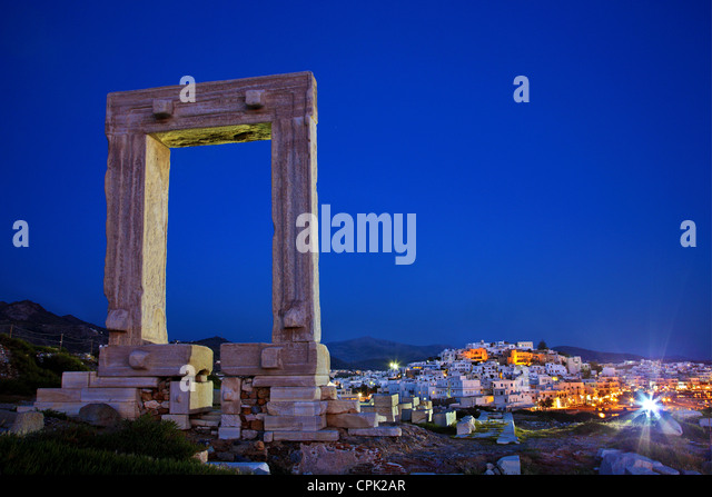 "The Portara (temple of Apollo) and the Chora (""capital"") of Naxos island in the background. Cyclades, - Stock Image"