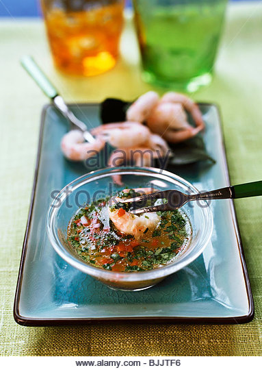 Shrimps with chili herb sauce - Stock Image