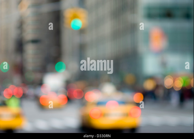 Abstract urban scene with traffic and taxi cabs, New York City. - Stock Image