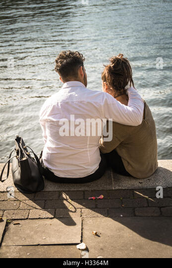 riverside-love-a-young-couple-sitting-on