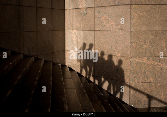 the-shadows-of-anonymous-people-are-seen