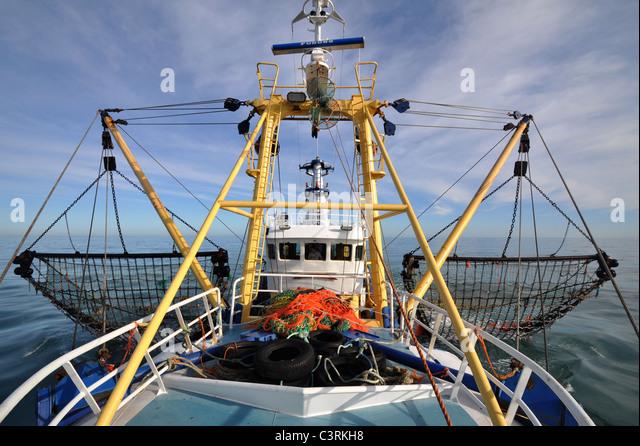 photo-of-a-beam-trawler-hauling-its-nets