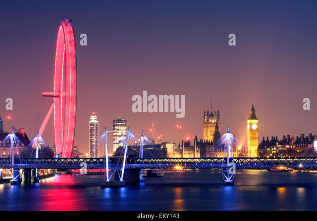 London at night. London Eye Hungerford Bridge and Golden Jubilee Bridges and Palace of Westminster with illuminated - Stock Image