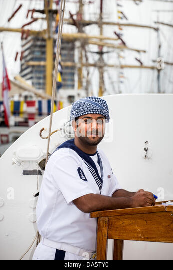 Aarhus, Denmark. 4th July, 2013. Crew member at The Royal Navy of Oman vessel Shabab Oman, during The Tall Ships - Stock Image