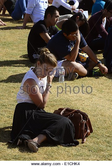epa04228906 A woman wipes tears from her eyes during a memorial event for the six UCSB students killed and 13 wounded - Stock Image