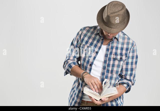 Man reading book - Stock Image