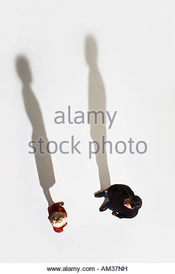 two people standing and looking at each other - Stock Image