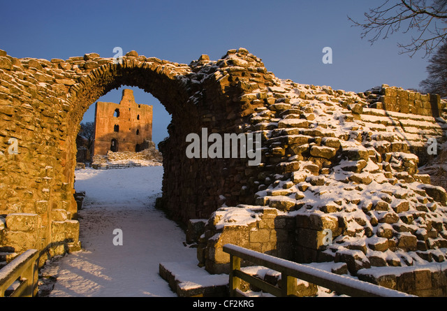 Norham Castle, one of the most important of the Border castles was built in 1121 by the Bishops of Durham. A long - Stock Image