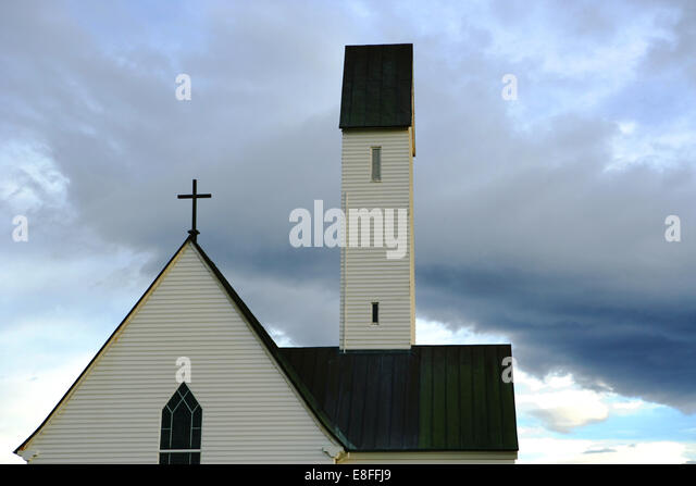 Iceland, Top section of church against moody sky - Stock Image