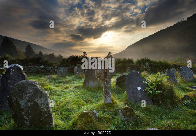 the graveyard at Glendalough, Wicklow Mountains, County Wicklow, Ireland - Stock Image