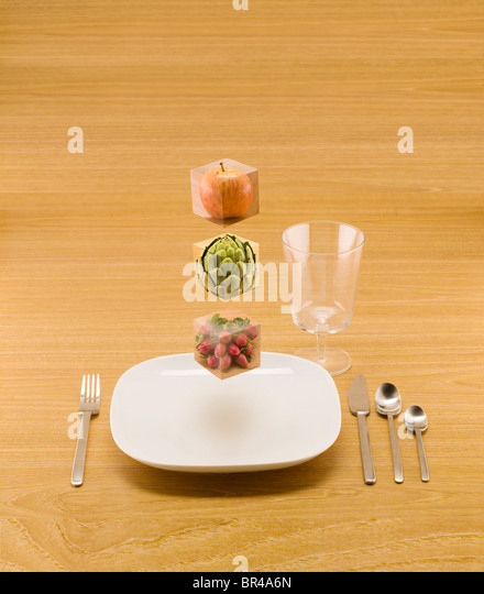 floating blocks of food to show the building blocks of your diet. - Stock Image