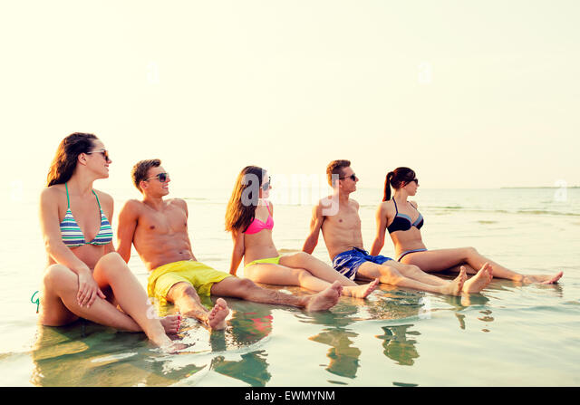 photo of girls sitting in water at beach № 16915
